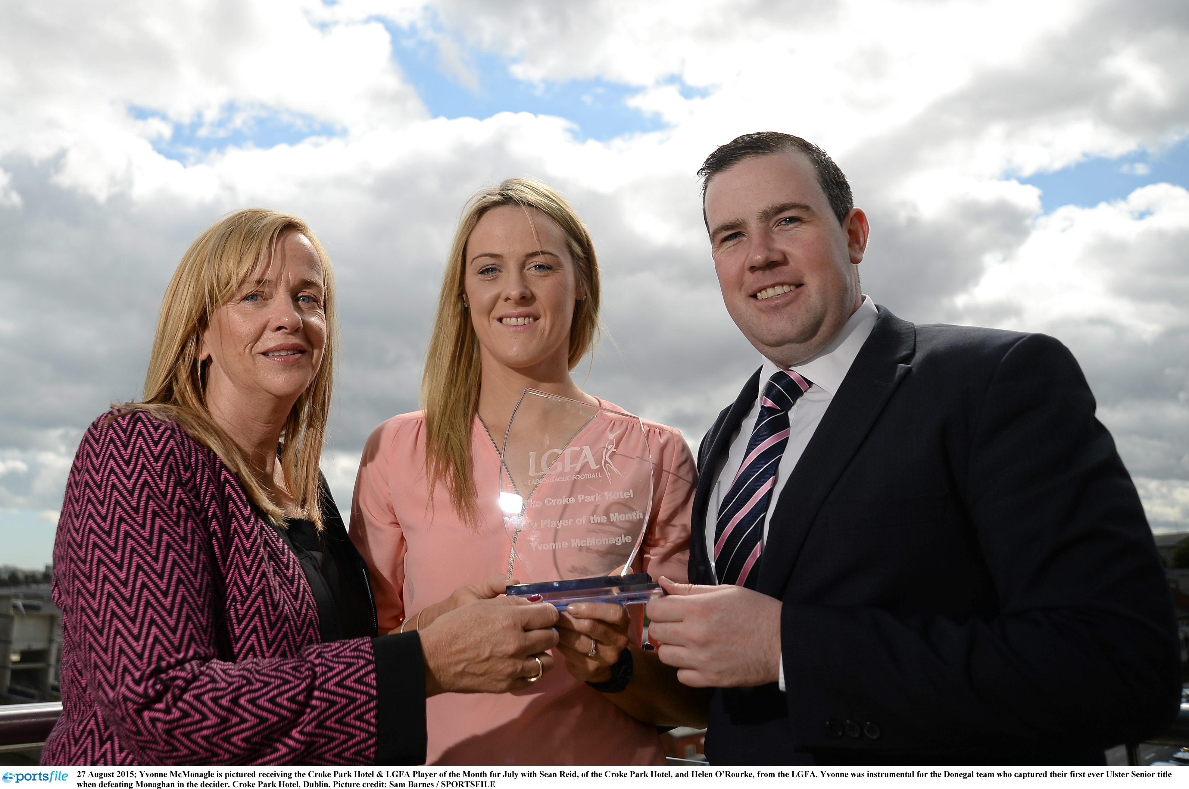 27 August 2015; Yvonne McMonagle is pictured receiving the Croke Park Hotel & LGFA Player of the Month for July with Sean Reid, of the Croke Park Hotel, and Helen O'Rourke, from the LGFA. Yvonne was instrumental for the Donegal team who captured their first ever Ulster Senior title when defeating Monaghan in the decider. Croke Park Hotel, Dublin. Picture credit: Sam Barnes / SPORTSFILE