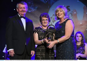 14 November 2015; Abby Brady, centre, Cavan is presented with her Hall of Fame award by Marie Hickey, President, LGFA, in the company of Pól O Gallchóir, Ceannsaí, TG4. 2015 LGFA TG4 Ladies Football Allstar Awards, CityWest Hotel, Saggart, Co. Dublin. Picture credit: Brendan Moran / SPORTSFILE