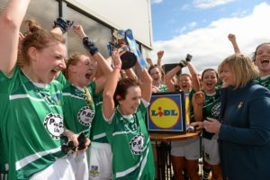 30 April 2016; Limerick captain Dymphna O'Brien lifts the cup as her team-mates celebrate. Lidl Ladies Football National League Division 4 Final, Antrim v Limerick, Clane, Co. Kildare. Picture credit: Matt Browne / SPORTSFILE *** NO REPRODUCTION FEE ***