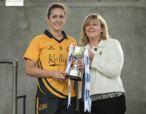 21 May 2016; Caroline O'Hanlon of Ulster is presented with he cup by LGFA President Marie Hickey following the MMI Ladies Football Interprovincial Football Cup Final, Ulster v Connacht, in Kinnegad, Co. Westmeath. Photo by Sam Barnes/Sportsfile *** NO REPRODUCTION FEE ***