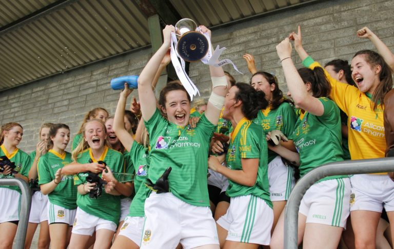 Captain Marion Farrelly raises the All Ireland trophy