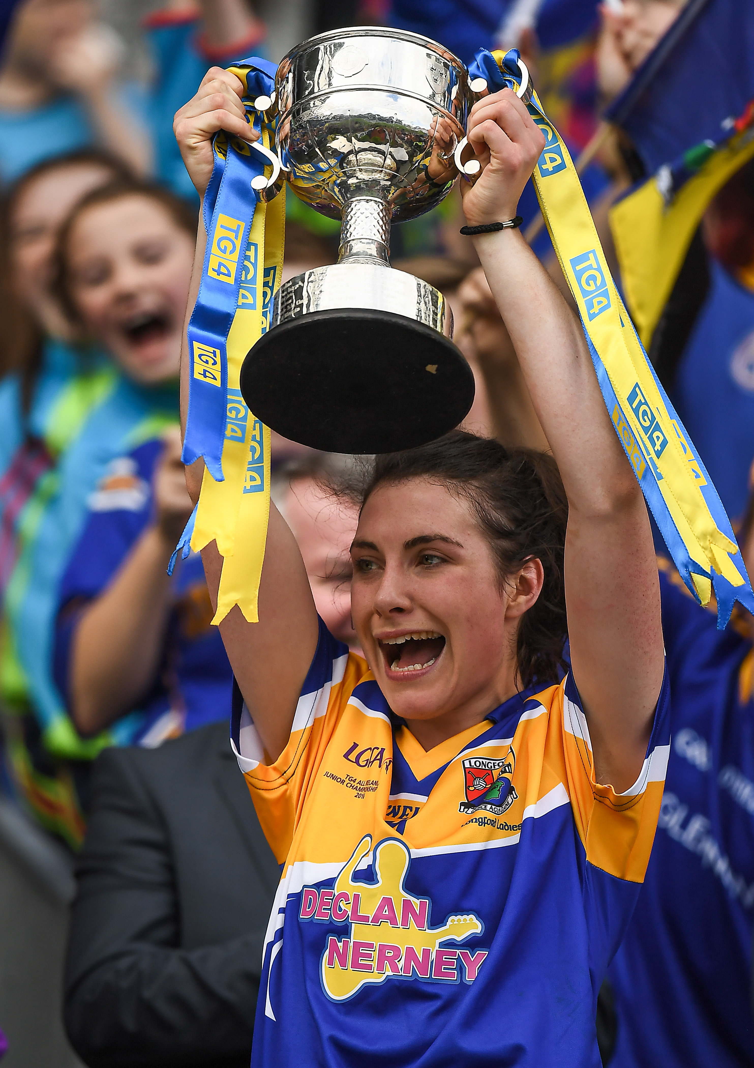 25 September 2016; Longford captain Mairéad Reynolds lifts the cup after the TG4 Ladies Football All-Ireland Junior Football Championship Final match between Antrim and Longford at Croke Park in Dublin.  Photo by Brendan Moran/Sportsfile *** NO REPRODUCTION FEE ***